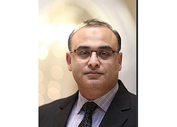Milton immigration consultant Ahmad Junaid Salik