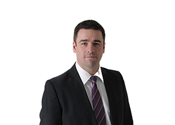 Fredericton real estate lawyer Andrew J. McGuire
