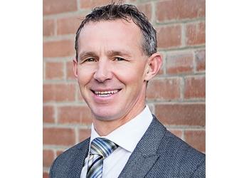 Calgary real estate agent Bryon Howard & The Howard Team - RE/MAX