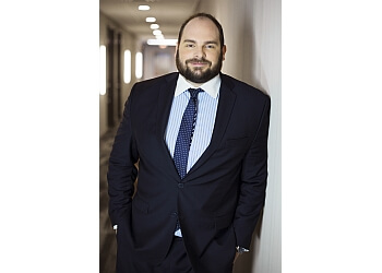 Surrey employment lawyer Christopher Drinovz