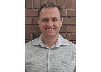 Ottawa dentist DR. ANATOLIJ KONIOUCHINE, DDS