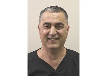 Cambridge cosmetic dentist DR. AYMAN SAMRA, DDS