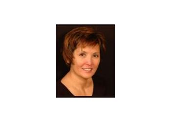 Abbotsford cosmetic dentist DR. CAROLINE Y. CESAR, DDS