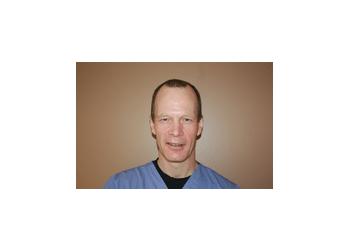 Chilliwack cosmetic dentist DR. GARTH M. HILDEBRAND, DDS