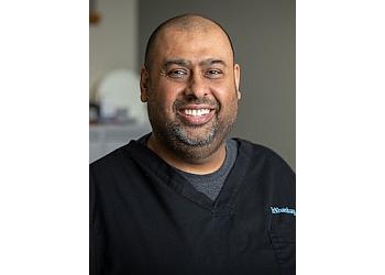 Guelph dentist DR. HARMINDER KHAMBAY