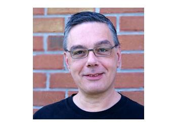 Barrie psychologist DR. LAMBROS MERMIGIS