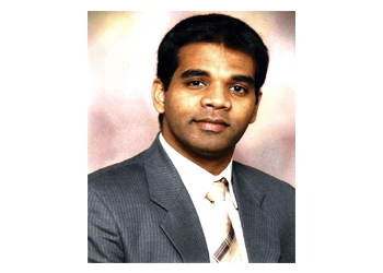 Cambridge dentist DR. PRAVEEN M J THOMAS, DDS