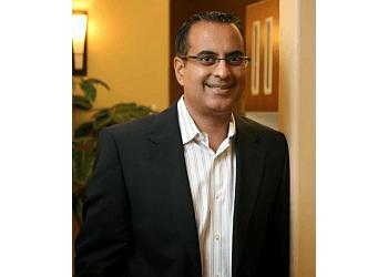 Whitby cosmetic dentist DR. SUNJAY GANDHI