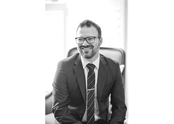 Guelph cosmetic dentist Dr. ANDRE BISSON, B.SC, DMD