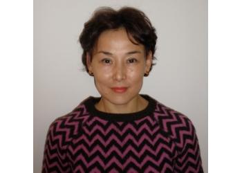 Richmond Hill dermatologist Dr. Akerke Baibergenova, MD, FRCPC, DABP, PhD, MPH