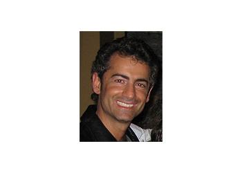 Delta children dentist Dr. Andreou, B.Sc, DDS