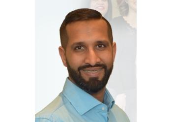 Milton cosmetic dentist Dr. Anil Rick Soordhar, DDS, DABCP, DFAACP, FAACP, AFAAID