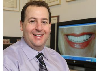 London cosmetic dentist Dr. Bruno Paliani, DDS, FAGD, FIADFE