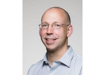 Kelowna orthopedic Dr. Derek Plausinis - KELOWNA ORTHOPEDICS