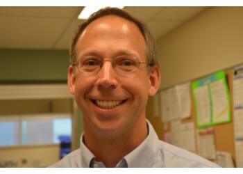 Kelowna orthopedic Dr. Derek Plausinis, MD