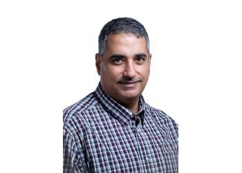 Calgary dentist Dr. Emad Tuma, DDS