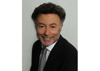 Oshawa dentist Dr. Frank Gold, DDS, FICDI