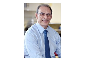 Winnipeg orthodontist Dr. Gary Levine, BPE, DMD, MSc, MRDC