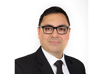 New Westminster dentist Dr. Gursharan Dhaliwal, DDS, FICOI, DICOI