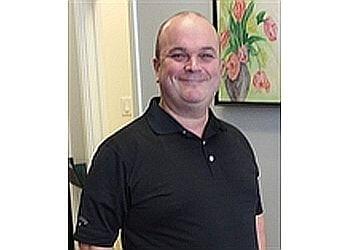 Brossard chiropractor Dr. Jerome Minville, Chiropraticien DC
