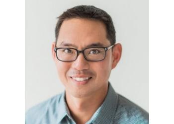 Milton chiropractor  Dr. John Kim, DC