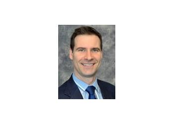 Dr. John Milne, CD, LRAM, BSc, DC
