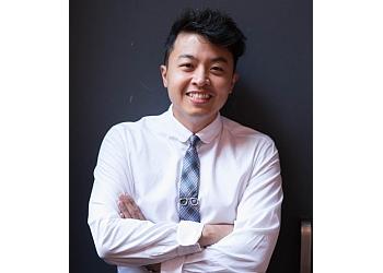 Toronto children dentist Dr. John Woo, B.Sc., DDS, FRCD