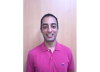 Port Coquitlam cosmetic dentist Dr. Kiavash Hossini, DDS