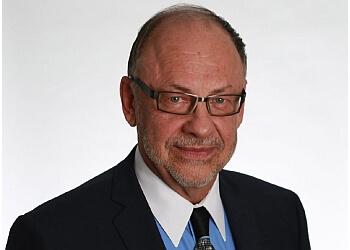 Burlington gynecologist Dr. Lawrence D. Komer, MD