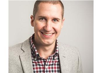 Calgary ent doctor Dr. Luke Rudmik, MD