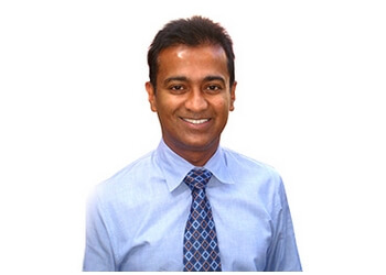 Richmond Hill dermatologist Dr. Mani Raman, MSc, MD, FRCPC