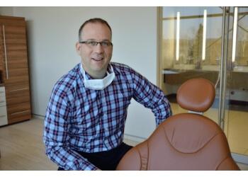 Moncton orthodontist Dr. Martin Braces, DDS