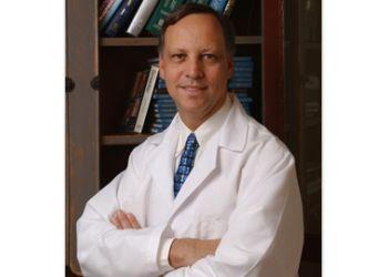 Mississauga plastic surgeon Dr. Michael J. Weinberg, MD, MSC, FRCS(C)