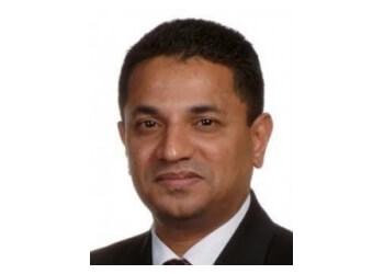 Milton dentist Dr. Nibu Varguise, DDS, MS, MDS