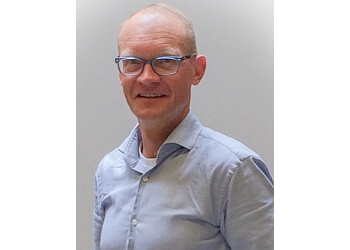 Oshawa orthodontist Dr. Norm Riekenbrauck, DDS