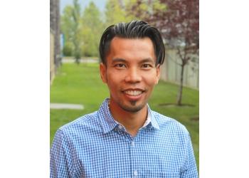Airdrie cosmetic dentist Dr. Quoc Quach, DDS