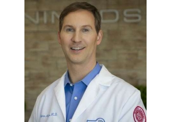 Brossard plastic surgeon Dr. Réjean Arbor, MD, FRCSC