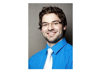 Longueuil chiropractor Dr. Raymond, Chiropraticien DC