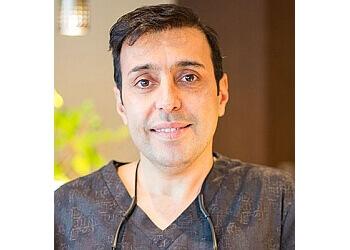 Coquitlam dentist Dr. Reza A. Hassiri, DMD