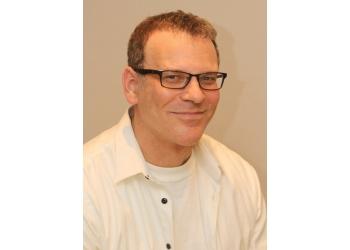 Brampton cosmetic dentist Dr. Robert Axelrad, DDS