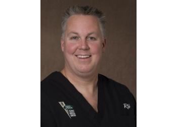 Orangeville cosmetic dentist Dr. Robert Vangalen, DDS