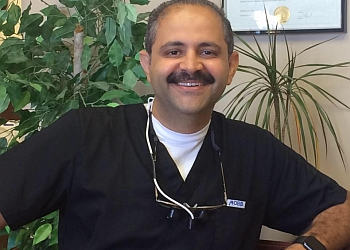 Oshawa cosmetic dentist Dr. Romani Nashid, HBSC, DDS