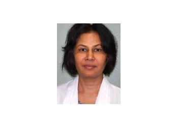 Brampton dermatologist Dr. Sharma Shakti, MD, FRCPR, DABD