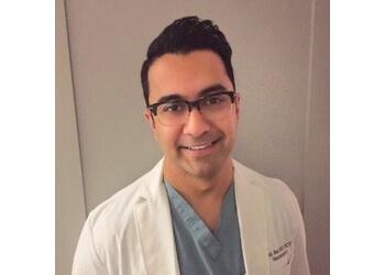 Mississauga neurosurgeon Dr. Sumit Jhas - THE ANEURYSM CLINIC