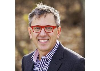 Winnipeg orthodontist Dr. Tim Dumore, DMD, BSc, MSc