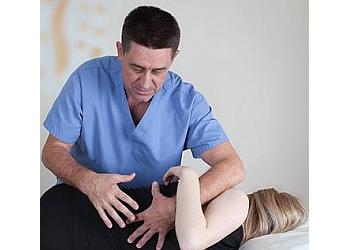 Mississauga osteopath Yuri Neuchev, RMT, Ph.D., M.D