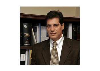 Ajax business lawyer John S. Tucciarone