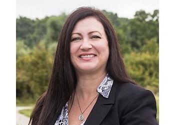 Hamilton real estate agent Kathy Della-Nebbia
