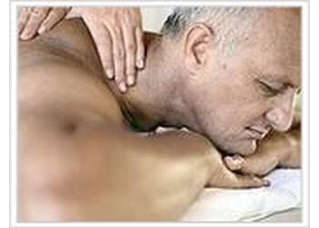 Regina manual osteopath Kivil Woodward, MA, DO
