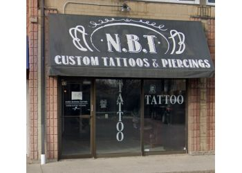 Milton tattoo shop Nude Buddha Tattoo Studio